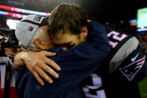 FOXBORO, MA - JANUARY 18:  New England Patriots owner Robert Kraft celebrates with  Tom Brady #12 after defeating the Indianapolis Colts in the 2015 AFC Championship Game at Gillette Stadium on January 18, 2015 in Foxboro, Massachusetts.  The Patriots defeated the Colts 45-7.  (Photo by Elsa/Getty Images)