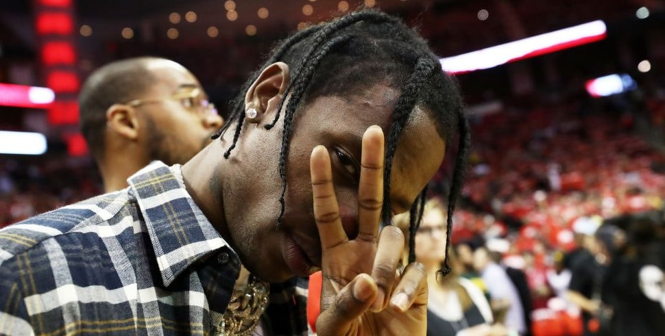 HOUSTON, TX - MAY 24:  Music artist Travis Scott poses prior to Game Five of the Western Conference Finals of the 2018 NBA Playoffs between the Houston Rockets and the Golden State Warriors at Toyota Center on May 24, 2018 in Houston, Texas. NOTE TO USER: User expressly acknowledges and agrees that, by downloading and or using this photograph, User is consenting to the terms and conditions of the Getty Images License Agreement. (Photo by Ronald Martinez/Getty Images)