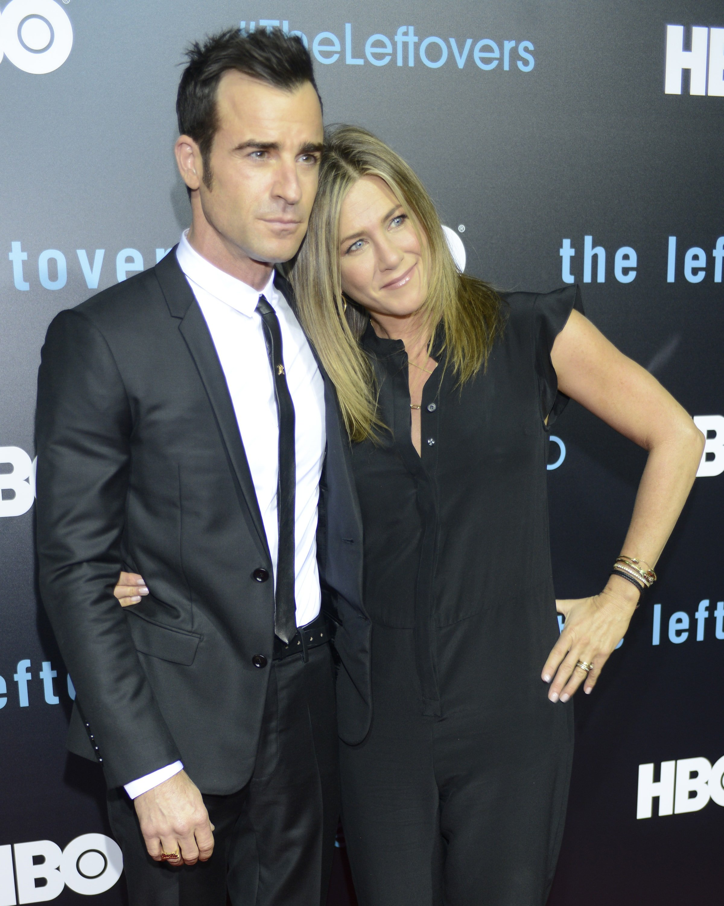 "AUSTIN, TX - OCTOBER 03:  Justin Theroux (L) and Jennifer Aniston attend HBO's ""The Leftovers"" Season 2 Premiere during The ATX Television Festival at the Paramount Theatre on October 3, 2015 in Austin, Texas.  (Photo by Tim Mosenfelder/Getty Images)"